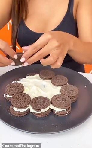 She repeated the step, placing the next layer of cookies on top before spreading another layer of cream