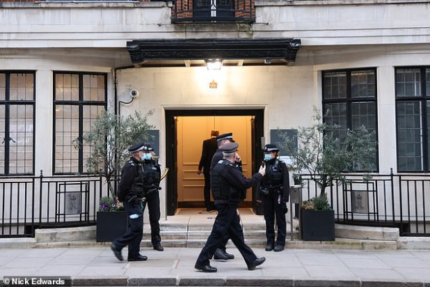 Police officers on patrol outside King Edward VII Hospital in Marylebone, London, this morning