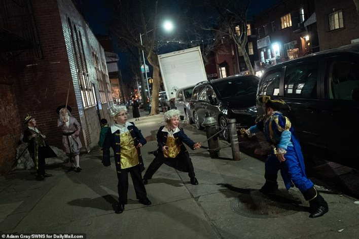 An all out pretend battle between royalty and pirates with plastic swords appeared to break out on the streets of Williamsburg