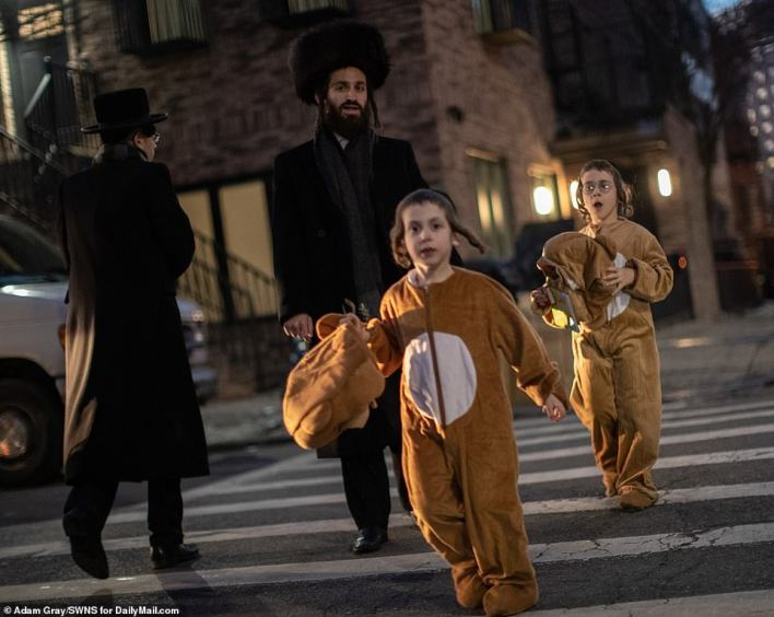 Two boys were caught crossing the street as they carried the heads to their bear costumes in their hands
