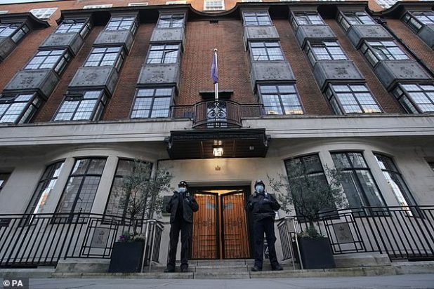 Police officers stand at the entrance to King Edward VII Hospital in London, where Prince Philip was admitted on the night of Tuesday, February 16.