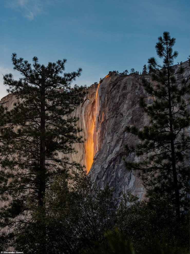 Sunlight hits the Horsetail Fall, turning it into a 'Firefall', at Yosemite National Park, California, in February 2021