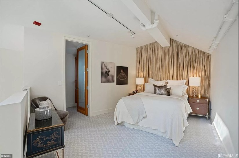 On the second floor can be found a loft-style bedroom (pictured), a full bath and and a walk-in-closet