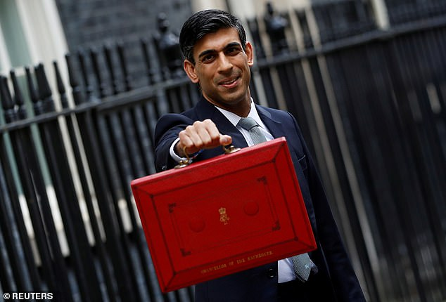 Chancellor Rishi Sunak, pictured last March on Budget Day will deliver his second budget speech next week where he will announce the creation of the new Taxpayer Protection Taskforce will have 1,265 staff and be based in HM Revenue and Customs (HMRC)