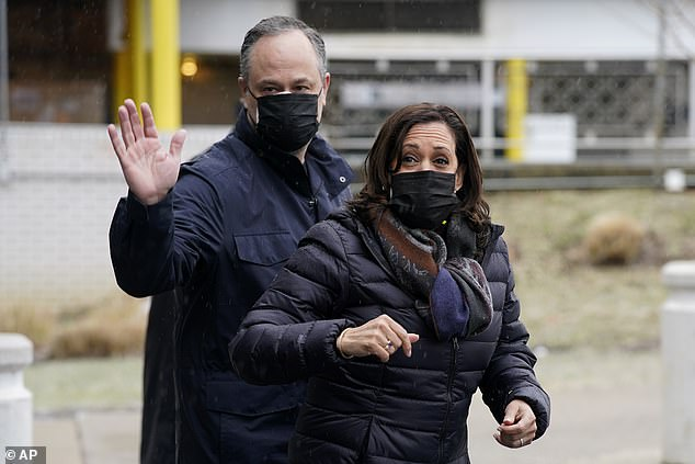 A hilarious clip from Jimmy Kimmel Live! clip has shown Americans struggling to identify Second Gentleman Doug Emhoff with one baffled man asking if he is a 'Vince Vaughn impersonator'. Pictured Emhoff and Kamala Harris