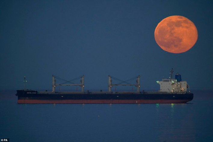 The names have been compiled by the Farmer's Almanac, which first published a list of names for full moons inspired by Native American tribes in the 1930s. It reached its full size at 8.17pm - but will appear to be full through to early Sunday morning. Pictured: The moonbehind a ship off Tynemouth, in Tyne and Wear