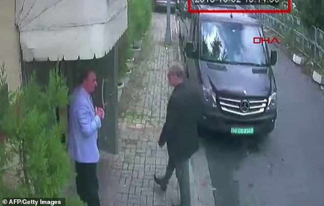 This video grab made on October 10, 2018 from CCTV footage obtained from Turkish news agency DHA shows Saudi journalist Jamal Khashoggi (R) arriving at the Saudi Arabian consulate in Istanbul on October 2, 2018. He vanished the same day after entering the consulate to obtain official documents ahead of his marriage to his Turkish fiancee