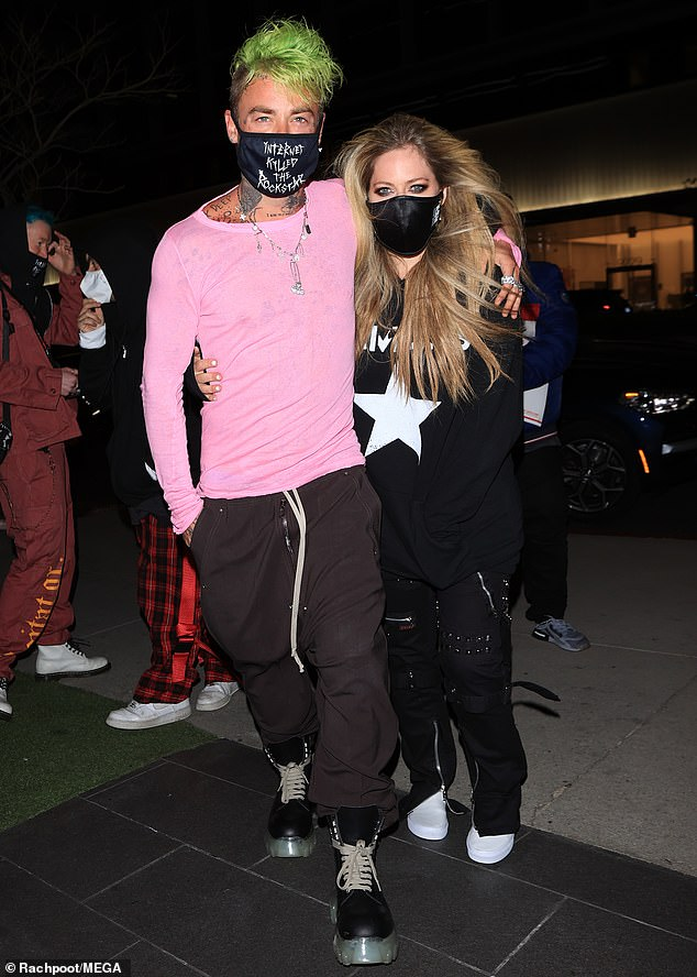 Loved-up: Avril Lavigne, 36, and her boyfriend Mod Sun, 33, had their arms wrapped around each other as they arrived at West Hollywood's upscale BOA Steakhouse on Saturday
