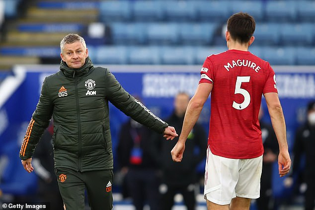 Solskjaer (left) wants to add more more experience to his backline alongside Harry Maguire