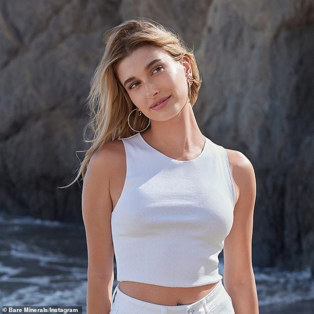 Pretty: The stunning 24-year-old model also posed for a photo on the beach in another image from the event, this time on the brand's Instagram page.