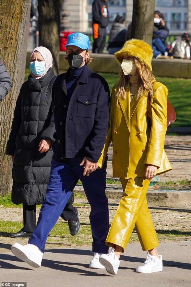 Close: During their sighting together in Paris, Hailey wore a monochrome look;  She wore a dusty yellow leather jacket with matching shorts, adding a plush hat, a brown handbag, and Nike Air Force One sneakers.