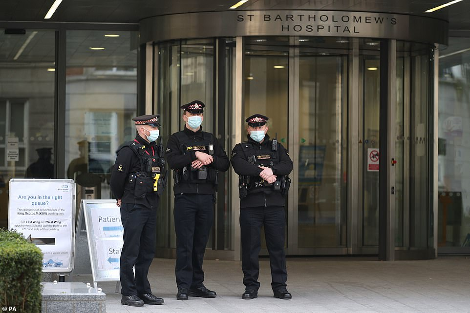 Officers from the City of London Police outside St Bartholomew's Hospital in London, where the Duke of Edinburgh has been transferred for treatment for an infection and testing and observation for a pre-existing heart condition