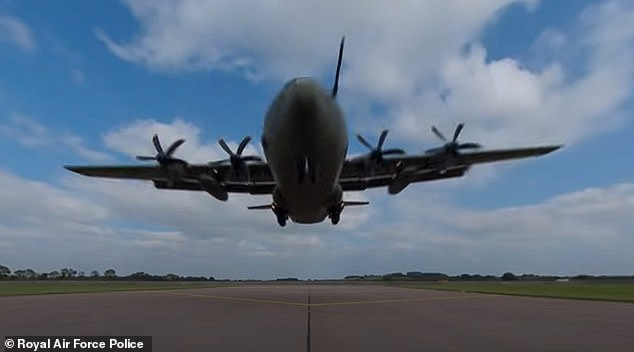 'You might want to mind your head for this one': The six-minute-long video places viewers under a C-130 Hercules aircraft moments prior to landing
