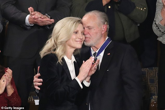 Rush Limbaugh pictured embracing his wife in February 2020. Limbaugh, 70, passed away on February 1 due to complications with lung cancer