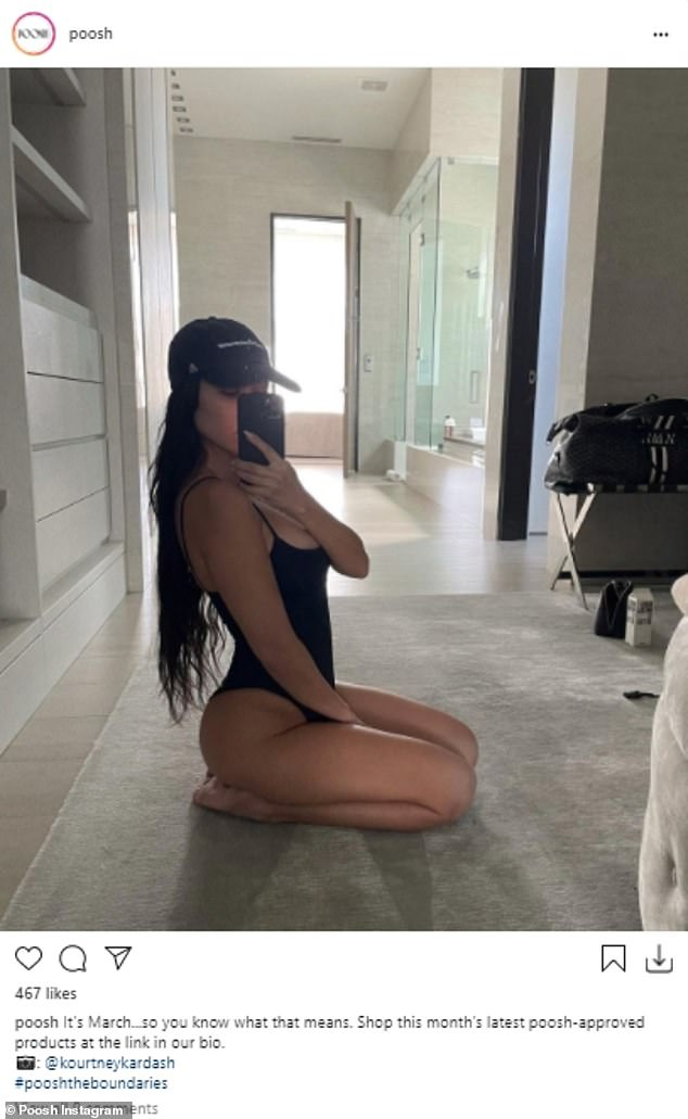 Mom at work: Kourtney Kardashian was busy promoting the last drop of product on her Poosh website to her 112 million Instagram followers by donning a swimsuit on Wednesday