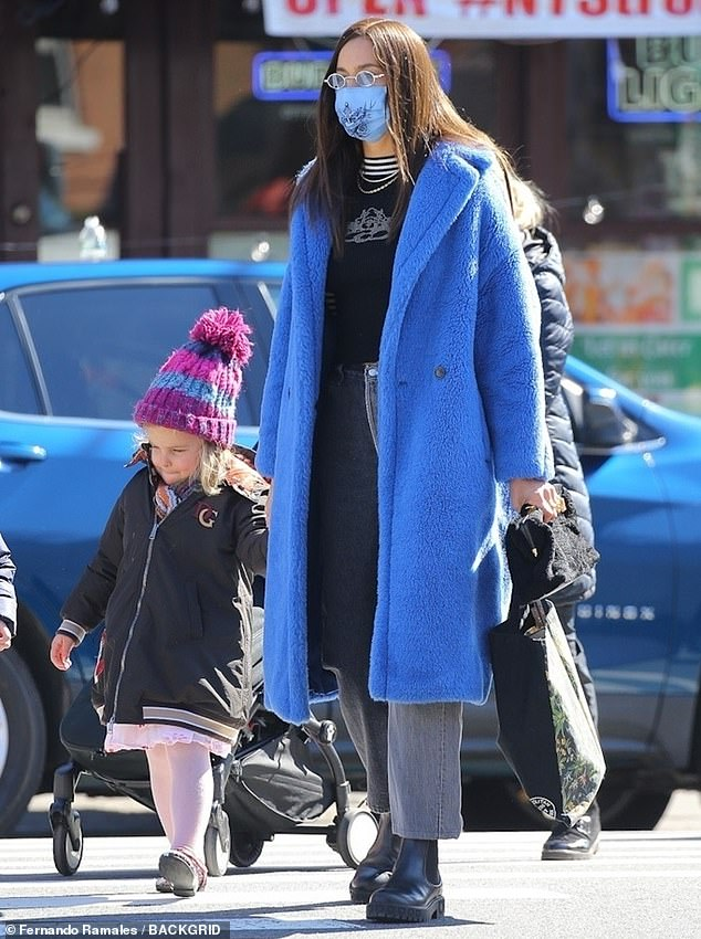 Mom's homework: Irina Shayk was spotted picking up her three-year-old daughter, Lea De Seine, wearing a long, blue Max Mara plush coat on Wednesday