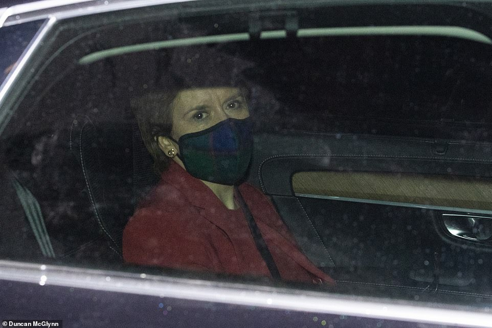 First Minister Nicola Sturgeon in the back of a chauffeur driven car leaving the Scottish Parliament in Holyrood, Edinburgh, on Wednesday night after a gruelling eight hours before the Holyrood committee