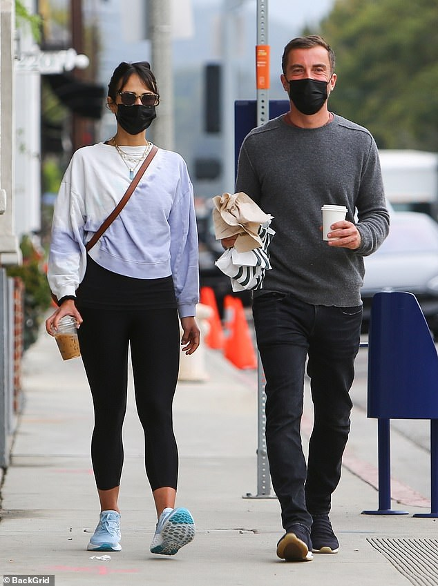 Relaxed: Jordana Brewster and Mason Morfit dated for their regular coffee in the Brentwood neighborhood of Los Angeles on Thursday, each carrying a drink as they walked around.