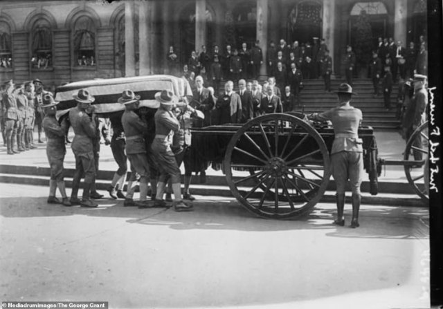 """A casket containing the body of former New York City mayor John Purroy Mitchel is loaded onto a wagon in 1918, with former President Theodore Roosevelt seen in the background, amongst other officials, holding their hats in respect for the deceased politician. Aged just 34 when he took office, Mitchel was the second-youngest mayor and he is sometimes referred to as """"The Boy Mayor of New York"""". He was killed in an aircraft accident in 1918 after his plane nosedived during a short military training flight"""
