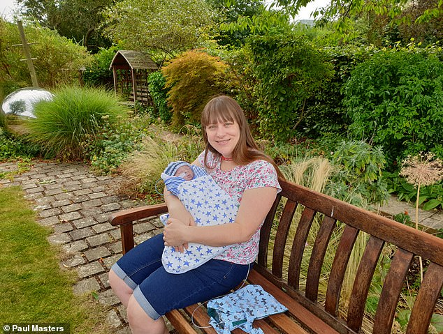 The family spent three days at the hospice before Ryan died at nine days old and the baby, who was named Ryan David after Siobhan's late father David, was able to meet his grandparents. Pictured, Siobhan with Ryan in the grounds of the hospice