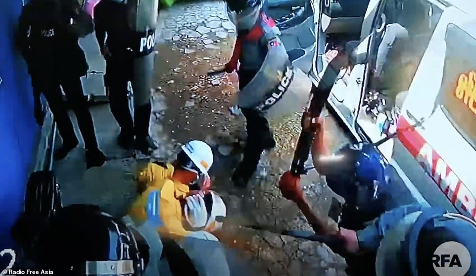 Horrific footage has emerged of three medics being surrounded by at least a dozen police officers who were kicking and punching them and even hitting them with their guns as they tried to cower away from the violence
