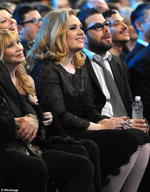 Package: The publication claims that the singer and charity CEO submitted a 'judgement package' last month in which the former couple 'opted to determine rights to community property and debts through mediation' (Adele and Simon pictured in 2012)