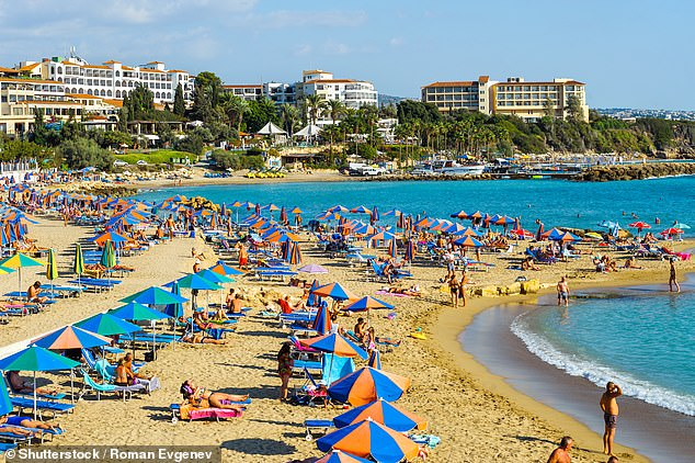 Holidaymakers on Coral Bay beach in Cyprus in October 2017