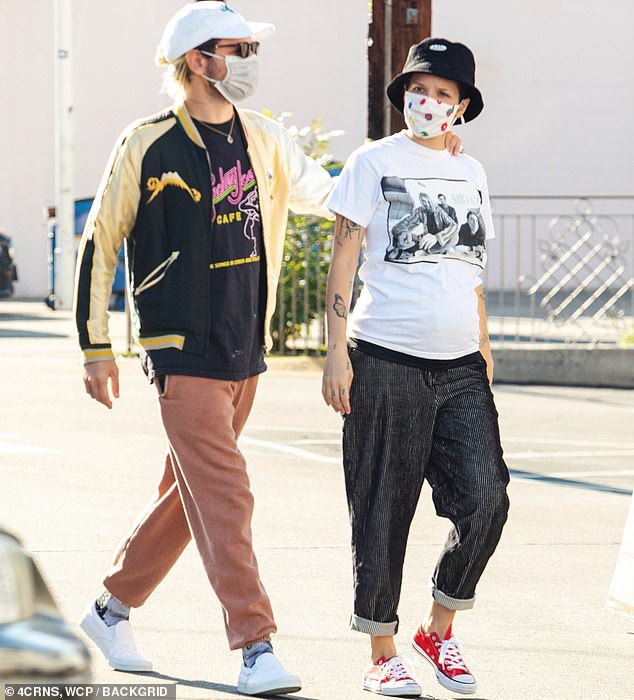 Side by side: The 26-year-old singer born Ashley Frangipane was accompanied by her boyfriend Alev Aydin who is the father of her child