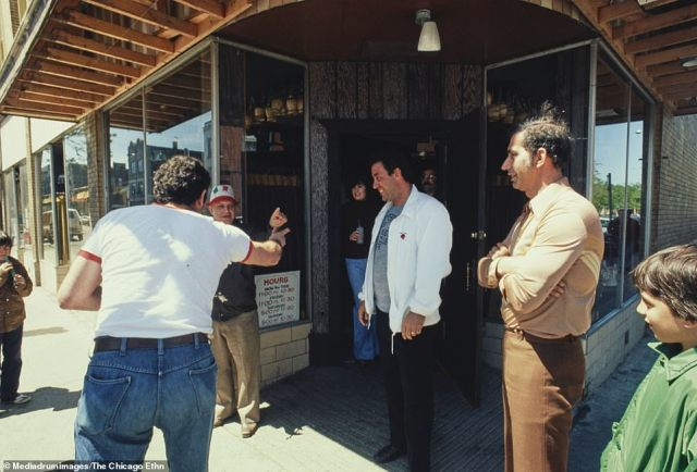 Italian morra players at Mama Sue's Restaurant, Taylor and Loomis Streets. Incredible colour photographs capturing the vibrant traditions of ethnic communities in Chicago during the late seventies have been revealed
