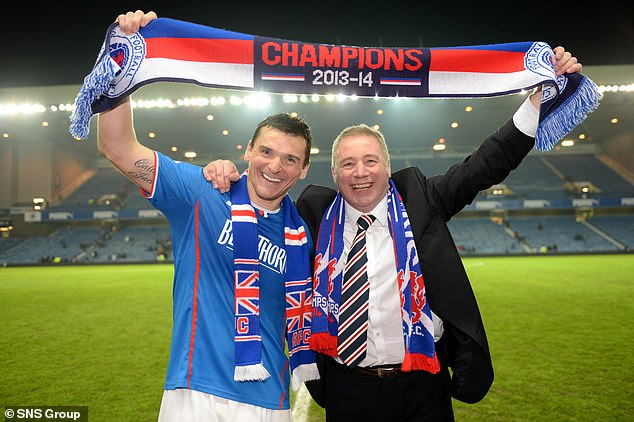 Lee McCulloch celebrates with Ally McCoist after securing the League One title at Ibrox