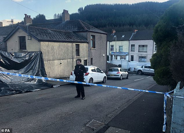 Police at the scene in the village of Ynyswen in Treorchy, Rhondda after a serious incident