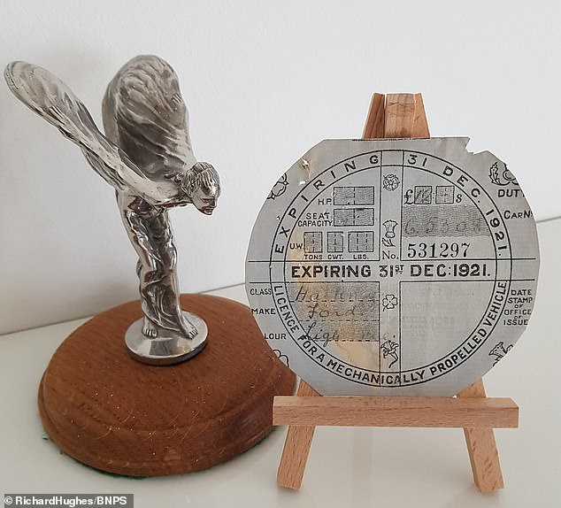 Pride of place: The 1921 tax disc on display at Richard Hughes home