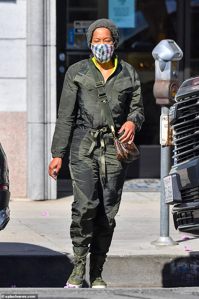 Trend-setter: On a casual day of racing, King still managed to look super chic in a military-inspired Nike Air Jordan tracksuit