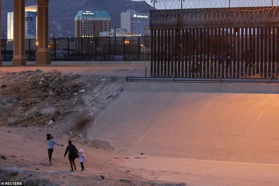 Migrants are seen going to turn themselves in to U.S. Border Patrol agents to request for asylum in Texas on Thursday