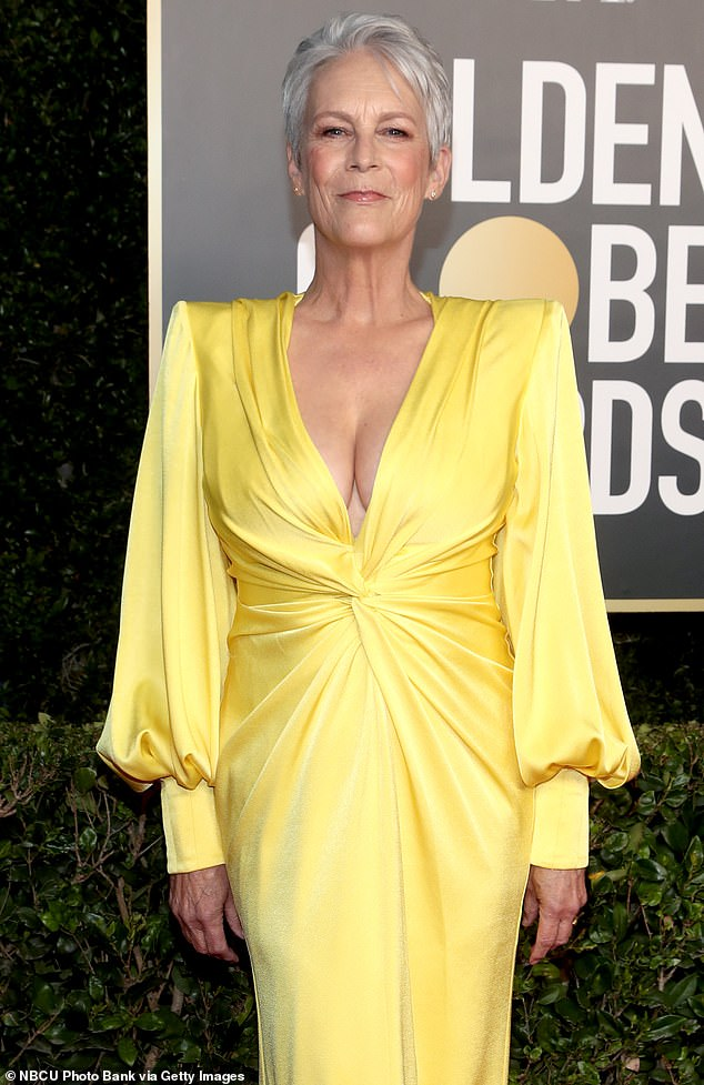 Busty display: Jamie Lee Curtispoked fun at her busty yellow Alex Perry gown, which she wore last weekend to present at the 79th Golden Globe Awards, as she appeared Friday on The Today Show