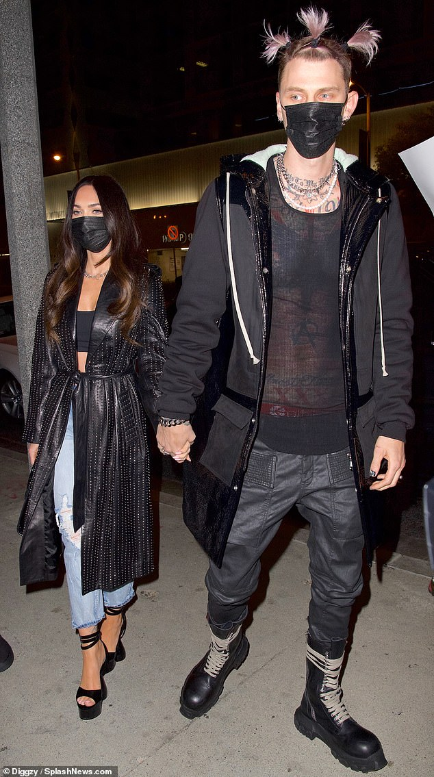 Couple: MGK was also seen wearing pink pigtails on a date in Los Angeles on Friday with girlfriend Megan Fox, 34
