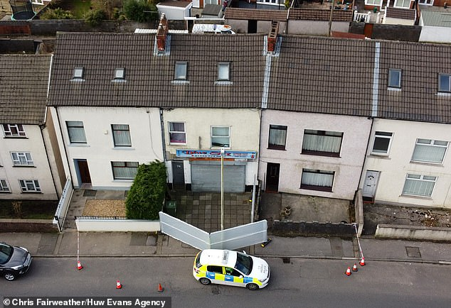 The schoolgirl lived above the Blue Sky takeaway in the rural village of Ynyswen (pictured this morning)