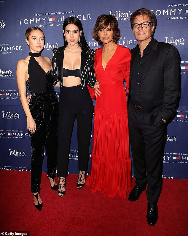 Protective: Her parents Lisa Rinna, 57, and Harry Hamlin, 69, were reportedly 'sceptical' about her relationship with Scott as the pair have an 18-year age gap (family pictured in 2017)