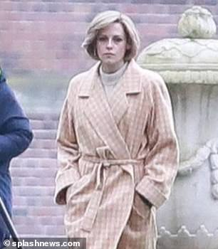 Iconic: The Twilight star sported Diana's signature blonde bob and teamed the look with black tights and leather boots