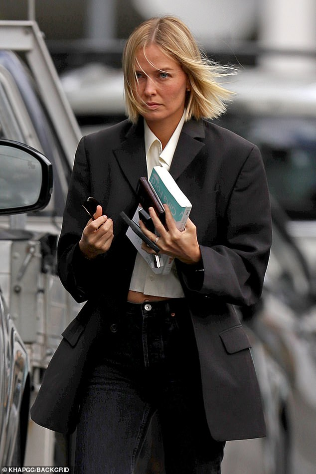 He is fine!  Model Lara Worthington (née Bingle - pictured) nailed business chic on Friday in a white collar shirt and black blazer as she attended meetings in Sydney