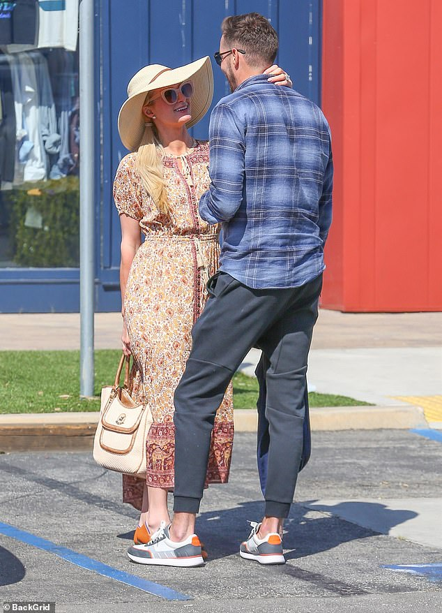 Affectionate: The two walked hand in hand and Paris stopped to put her hand on her love's neck as they chatted in a parking space