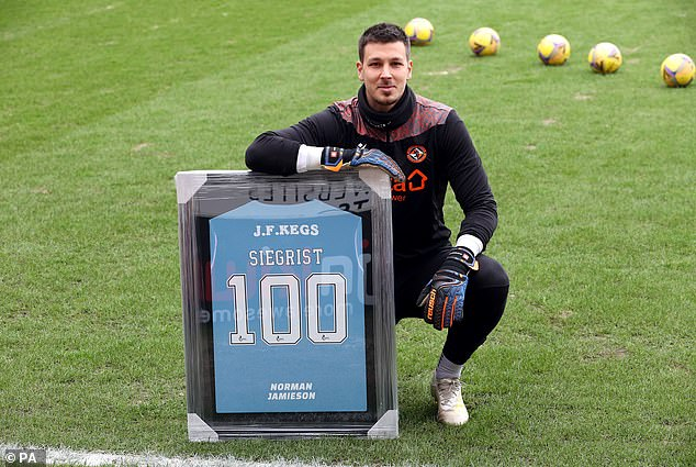 Dundee United goal-keeper Benjamin Siegrist made his 100th appearance for the Tangerines