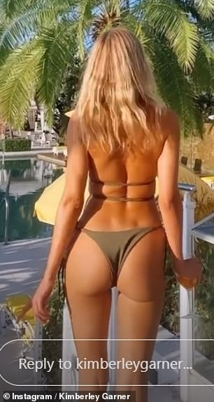 Special attention: Earlier today, the former Made In Chelsea star teamed up with a dark green bikini from her collection