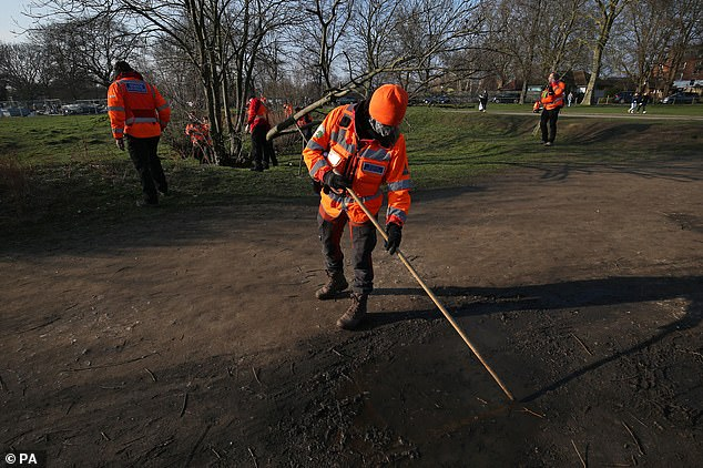 Officers have now revealed Ms Everard was spotted on CCTV at approximately 9.30pm on Wednesday. She was walking alone on the A205 Poynders Road, from the junction with Cavendish Road, in the direction of Tulse Hill. Pictured: Volunteers search for missing Sarah Everard on Clapham Common yesterday