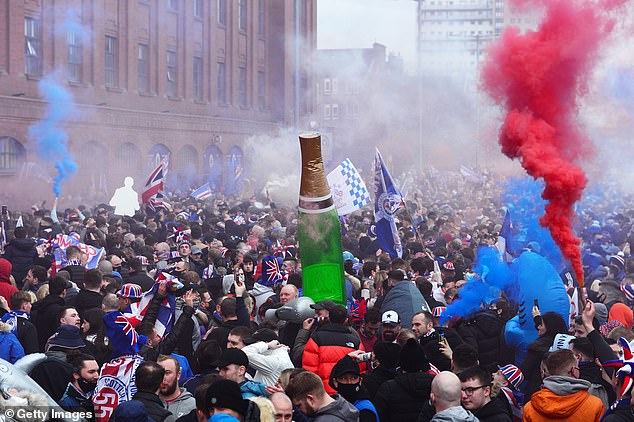 Despite the warning, fans turned out in their droves bringing inflatable champagne bottles, flags and flares