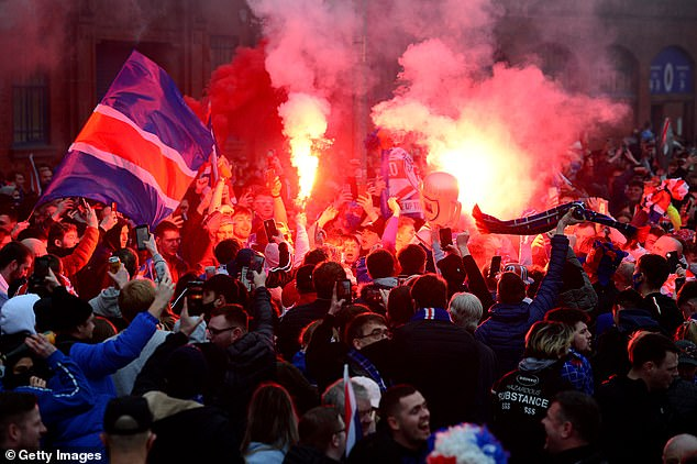 Rangers fans set off flares as they celebrated their side's 55th title win as Celtic drew