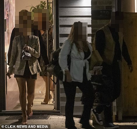 Glam team: A number of people were seen out of the door by Megan's pal