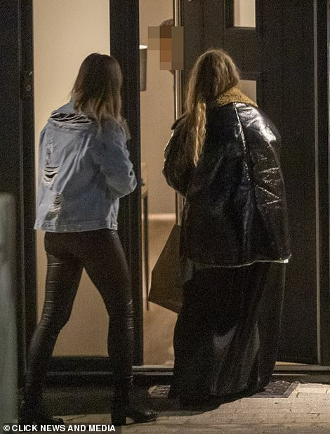 Greeting: A man seemed to open the door to two women