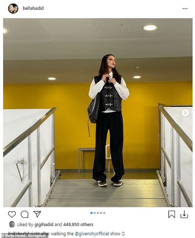 Queen of the catwalks: Bella Hadid, who walked in the Givenchy show, opted to post some pictures of herself `` right after '' storming the catwalk in a black vest, white blouse and a trousers