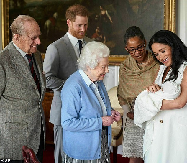 Meghan refused to say which royal had the conversation with Harry about Archie's skin colour, claiming it would be 'damaging' to the person in her husband's family who raised it. Pictured: The Queen and Prince Philip meeting Archie
